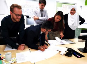 graduates doing group work in the training academy